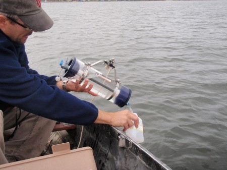 Mike Majeski from Emmons & Olivier Resources taking a water quality sample.