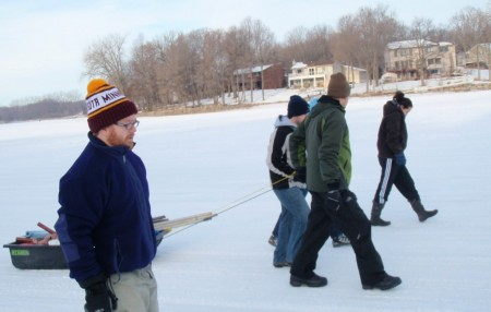 Trekking across the ice to the sample location on Upper Prior Lake.