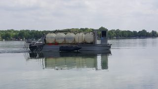 Barge applying alum on Spring Lake 2018