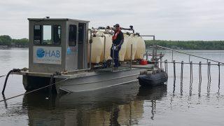 Barge applying alum on Spring Lake 2018